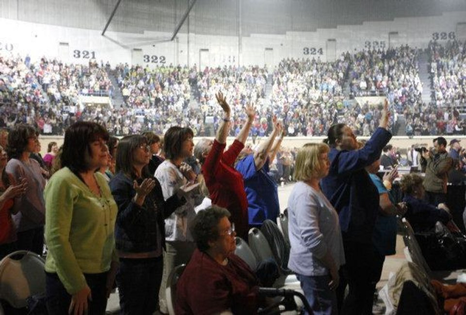 Photo - Women pray during the Women of Joy conference at the State Fair Arena, Friday, April 15, 2011, in Oklahoma City. Photo by Sarah Phipps, The Oklahoman ORG XMIT: KOD
