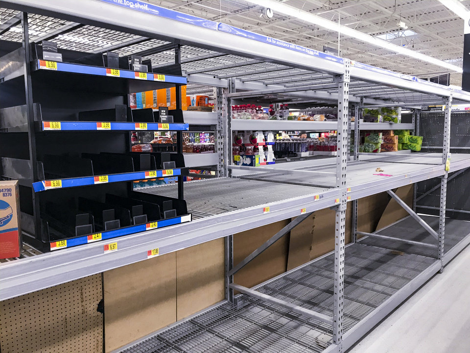 Photo - Empty shelves in the toilet paper isle at Walmart in Mustang, Okla. on Monday, March 16, 2020.    [Chris Landsberger/The Oklahoman]