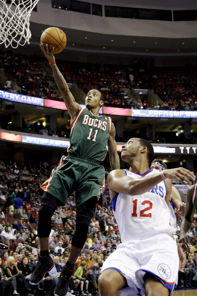 Milwaukee Bucks' Monta Ellis (11) shoots past Philadelphia 76ers' Evan Turner (12) in the first half of an NBA basketball game, Monday, Nov. 12, 2012, in Philadelphia. (AP Photo/Matt Slocum)