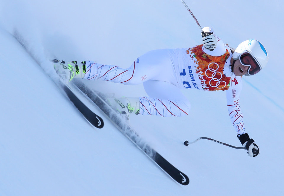 Photo - United States' Julia Mancuso makes a turn in a women's downhill training run for the Sochi 2014 Winter Olympics, Friday, Feb. 7, 2014, in Krasnaya Polyana, Russia. (AP Photo/Alessandro Trovati)