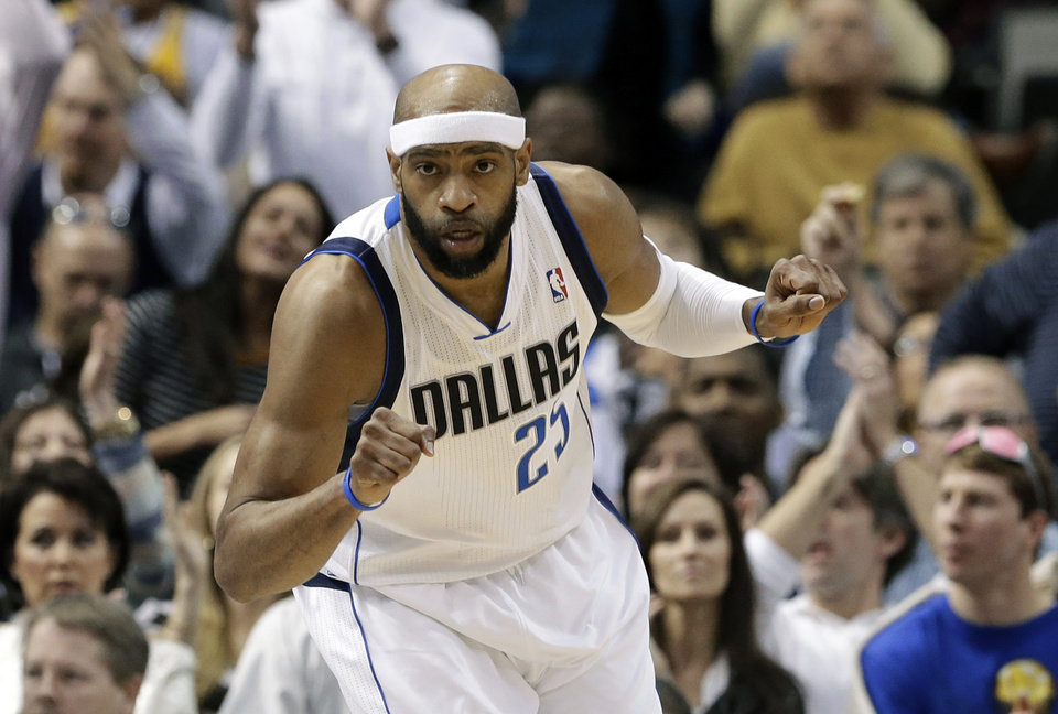 Dallas Mavericks' Vince Carter (25) celebrates after dunking against the Los Angeles Lakers in the first half of an NBA basketball game Sunday, Feb. 24, 2013, in Dallas. (AP Photo/Tony Gutierrez)