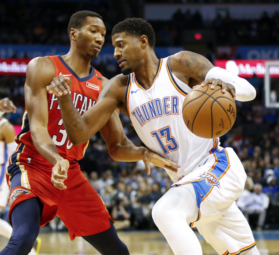 Photo - Oklahoma City's Paul George (13) drives as New Orleans' Wesley Johnson (33) defends during an NBA basketball game between the Oklahoma City Thunder and the New Orleans Pelicans at Chesapeake Energy Arena in Oklahoma City, Monday, Nov. 5, 2018. Photo by Nate Billings, The Oklahoman