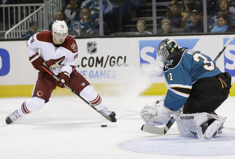 San Jose Sharks goalie Antti Niemi, of Finland, right, stops a shot attempt by Phoenix Coyotes right wing Mikkel Boedker, of Denmark, during the second period of an NHL hockey game in San Jose, Calif., Saturday, Feb. 9, 2013. (AP Photo/Marcio Jose Sanchez)