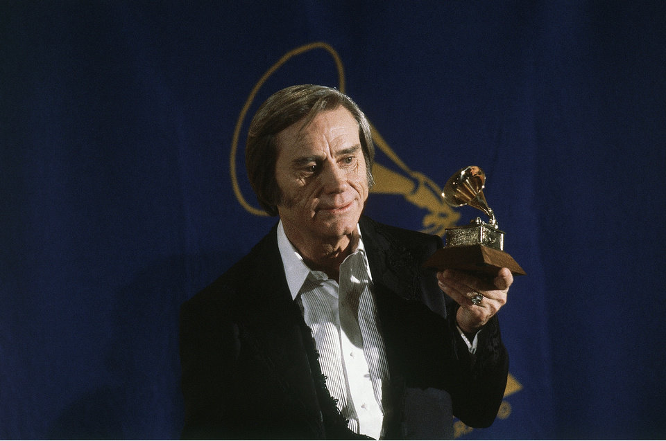 Photo - FILE - In this Feb. 25, 1981 file photo, Country singer George Jones poses with the Grammy he won for best male country vocal performance of