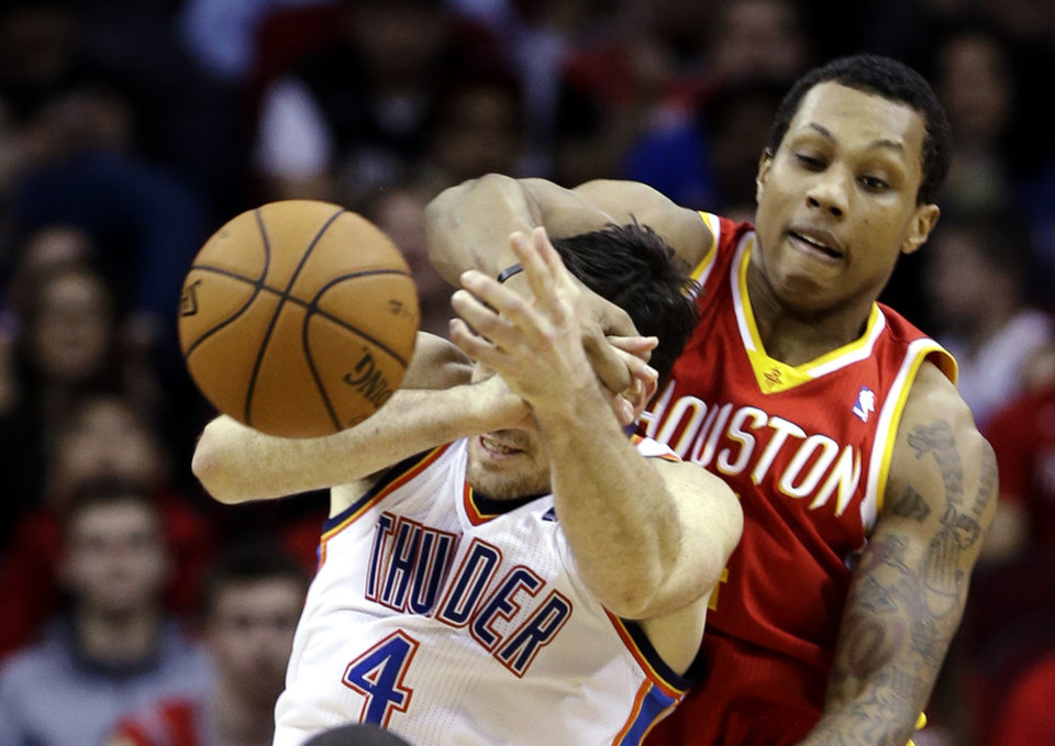 Oklahoma City Thunder's Nick Collison (4) is fouled by Houston Rockets' Greg Smith in the first half of an NBA basketball game, Wednesday, Feb. 20, 2013, in Houston. (AP Photo/Pat Sullivan) ORG XMIT: HTR101