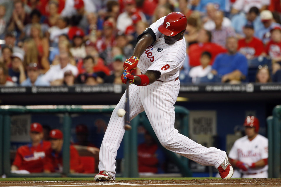 Photo - Philadelphia Phillies' Ryan Howard hits a home run off Houston Astros starting pitcher Dallas Keuchel during the second inning of an interleague baseball game, Tuesday, Aug. 5, 2014, in Philadelphia. (AP Photo/Matt Slocum)