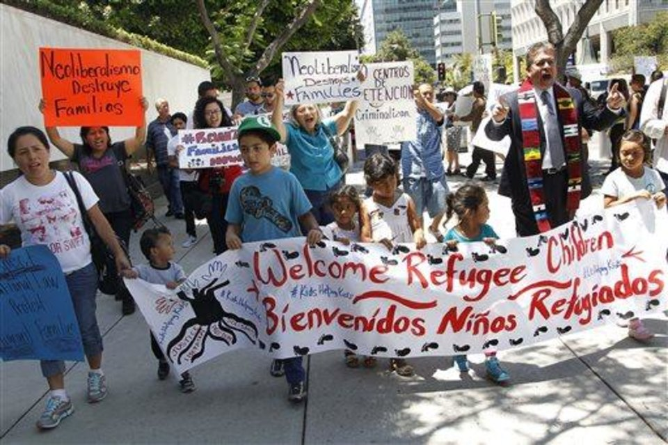 Photo - Immigrant families and children's advocates rally in response to President Barack Obama's statement on the crisis of unaccompanied children and families illegally entering the United States, outside the Los Angeles Federal building Monday, July 7, 2014. A top Obama administration official says no one, not even children trying to escape violent countries, can illegally enter the United States without eventually facing deportation proceedings. (AP Photo/ Nick Ut)
