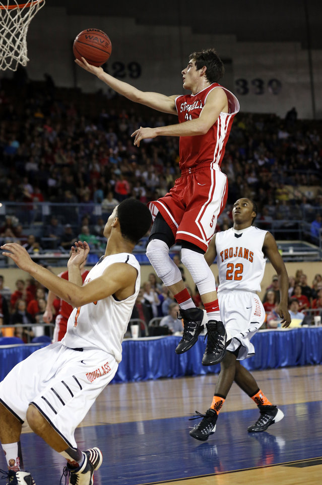Photo - Stilwell's Chase Littlejohn shoots as the Stilwell Indians play the Douglass Trojans in the finals of the State Class 4A Boys Basketball Tournament at the Fairgrounds Arena on Saturday, March 15, 2014, in Oklahoma City, Okla. Photo by Steve Sisney, The Oklahoman