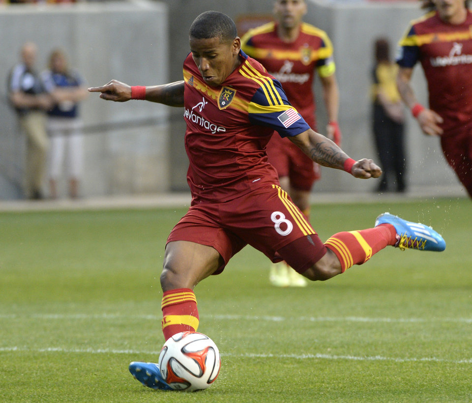 Photo - Real Salt Lakes forward Jou Plata (8) kicks for the team's first goal against Colorado Rapids during their MLS soccer game, Saturday, May 17, 2014, in Sandy, Utah. (AP Photo/The Salt Lake Tribune, Rick Egan)  DESERET NEWS OUT; LOCAL TV OUT; MAGS OUT.