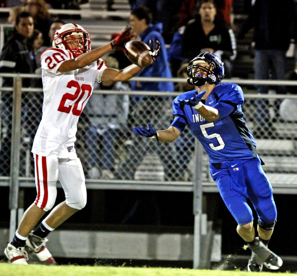 Prague's defensive back Damon Palmer (20) takes a pass from Little Axe's Jacob Bookout (5) in high school football on Friday, October 29, 2010, in Little Axe, Okla.  This is the first home game for Little Axe since they rebuilt the football stadium after the tornado destroyed it in the spring.  Photo by Steve Sisney, The Oklahoman