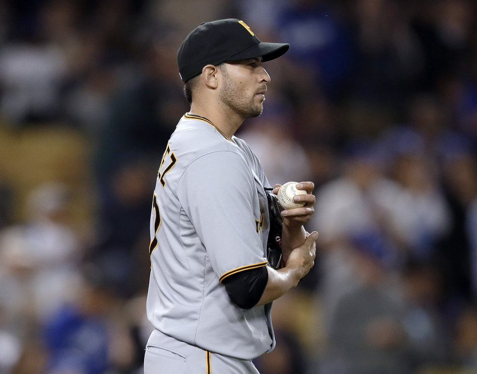 Pittsburgh Pirates pitcher Jonathan Sanchez returns to the mound after serving up a solo home run to Andre Ethier of the Los Angeles Dodgers in the second inning of a baseball game in Los Angeles on Friday, April 5, 2013. (AP Photo/Reed Saxon)