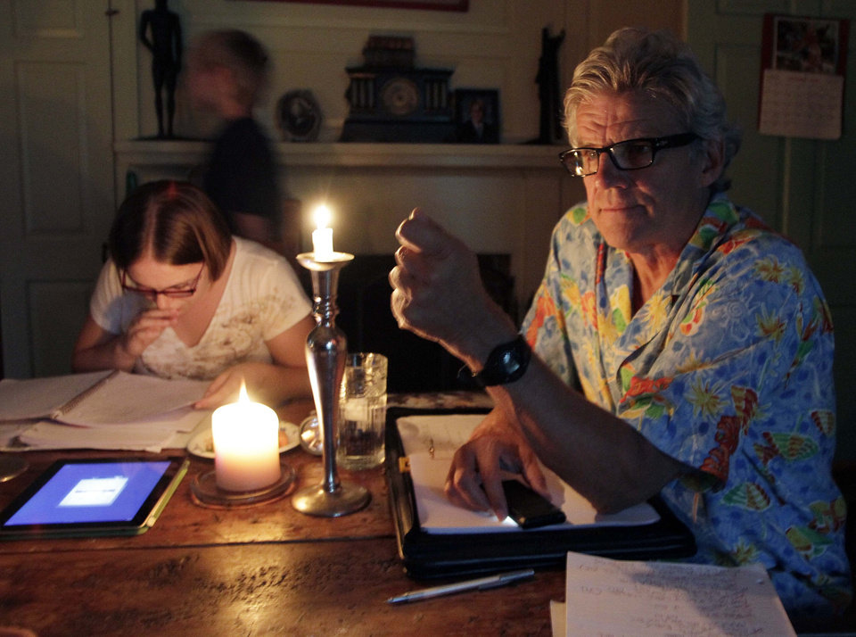 Photo -   In this photo taken Sunday Aug. 21, 2011 Academy Award winner Ernest Thompson use candles to go over the script after loosing power from a powerful thunderstorm in New Hampton, N.H. Thirty years after the academy award winning movie,