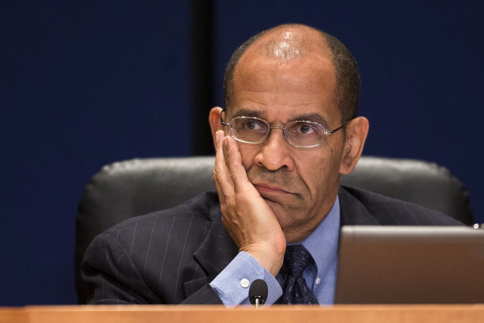 Photo - Acting National Transportation Safety Board (NTSB) Chairman Christopher Hart listens to investigators during an NTSB hearing to establish the cause of the Asiana Flight 214 airlines crash in San Francisco, and to make safety recommendations, Tuesday, June 24, 2014, in Washington. (AP Photo/ Evan Vucci)