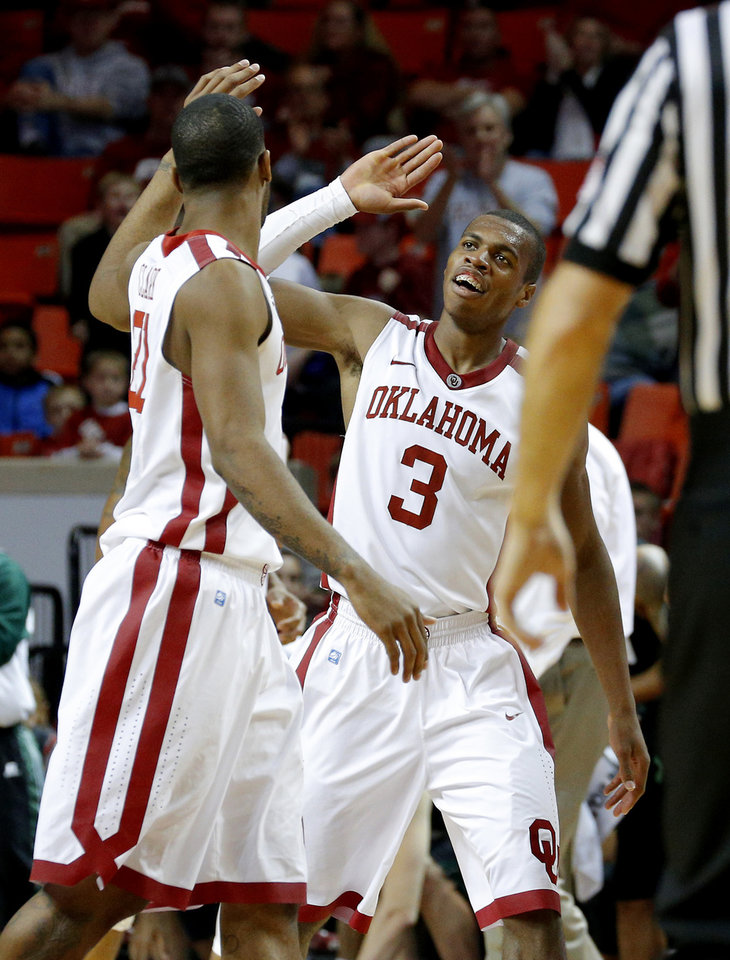 Photo - Oklahoma's Buddy Hield (3) celebrates with Cameron Clark (21) during a NCAA college basketball game between the University of Oklahoma (OU) and Ohio at the Lloyd Noble Center in Norman, Saturday, Dec. 29, 2012. Oklahoma won 74-63. Photo by Bryan Terry, The Oklahoman
