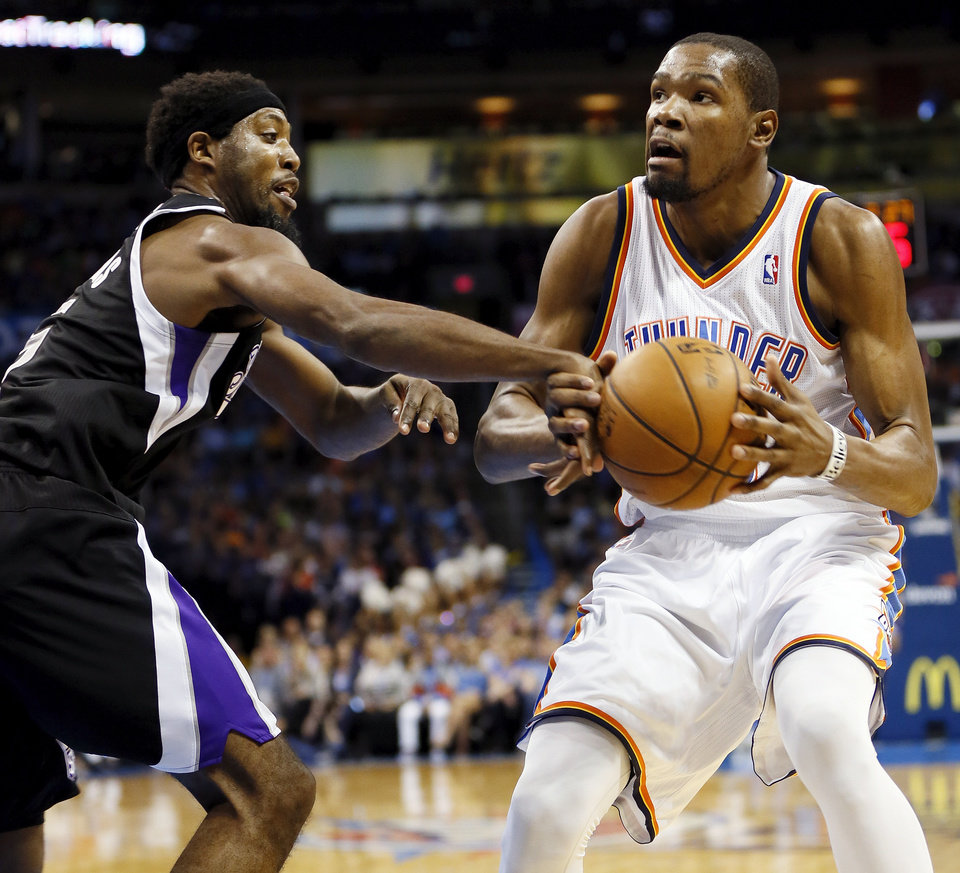 Sacramento\'s John Salmons (5) fouls Oklahoma City\'s Kevin Durant (35) during an NBA basketball game between the Oklahoma City Thunder and the Sacramento Kings at Chesapeake Energy Arena in Oklahoma City, Monday, April 15, 2013. Photo by Nate Billings, The Oklahoman