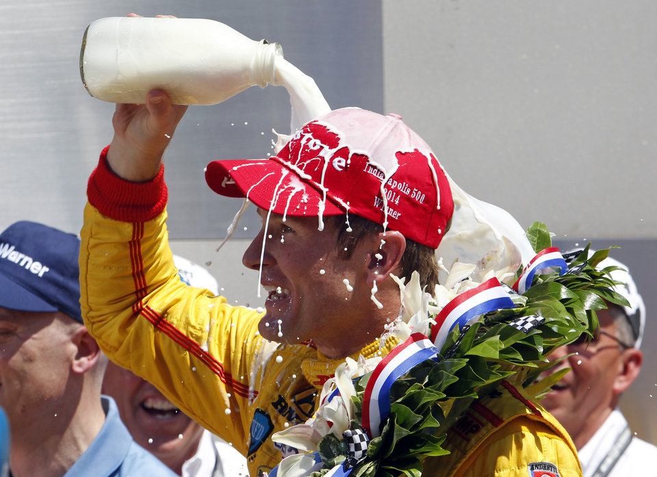 Photo - Ryan Hunter-Reay celebrates after winning the 98th running of the Indianapolis 500 IndyCar auto race at the Indianapolis Motor Speedway in Indianapolis, Sunday, May 25, 2014. (AP Photo/Tom Strattman)
