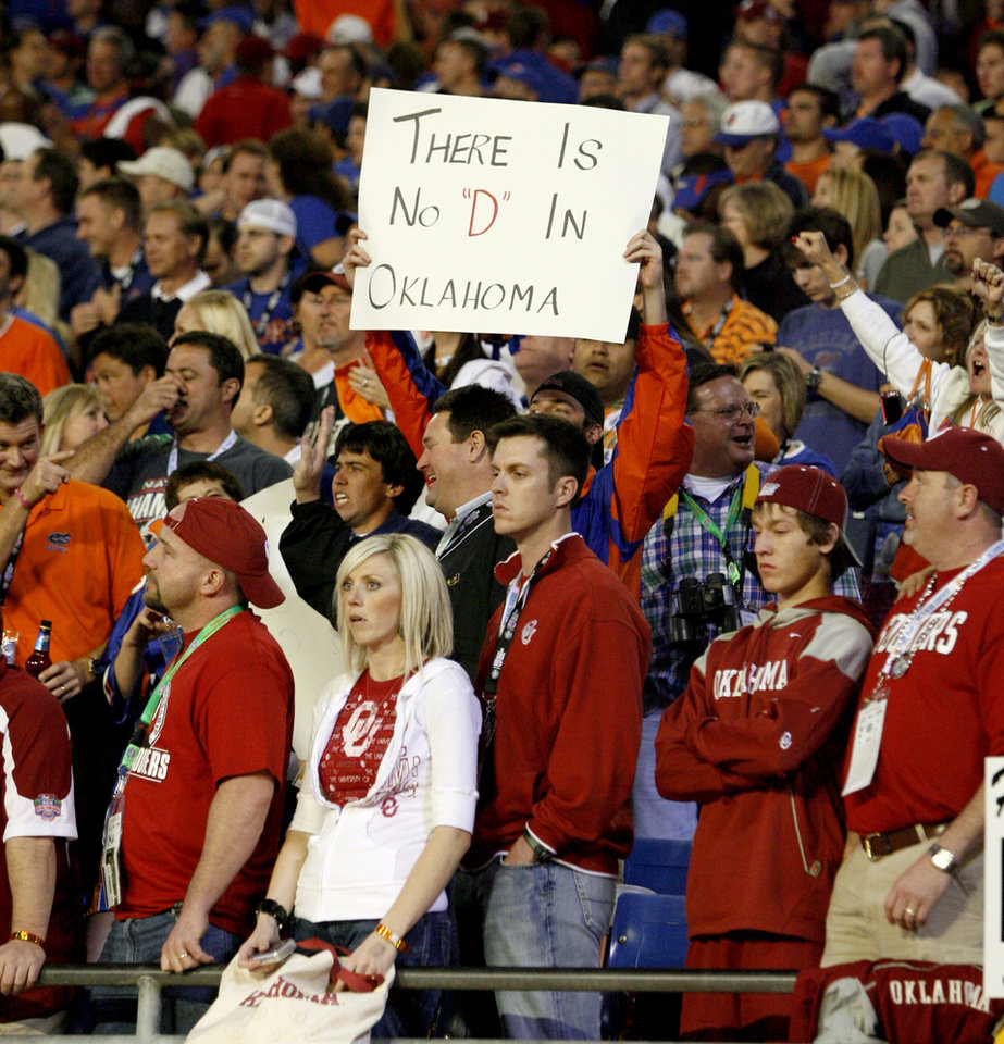 Photo - OU fans react after OU's 24-14 loss during in the BCS National Championship college football game between the University of Oklahoma Sooners (OU) and the University of Florida Gators (UF) on Thursday, Jan. 8, 2009, at Dolphin Stadium in Miami Gardens, Fla. 