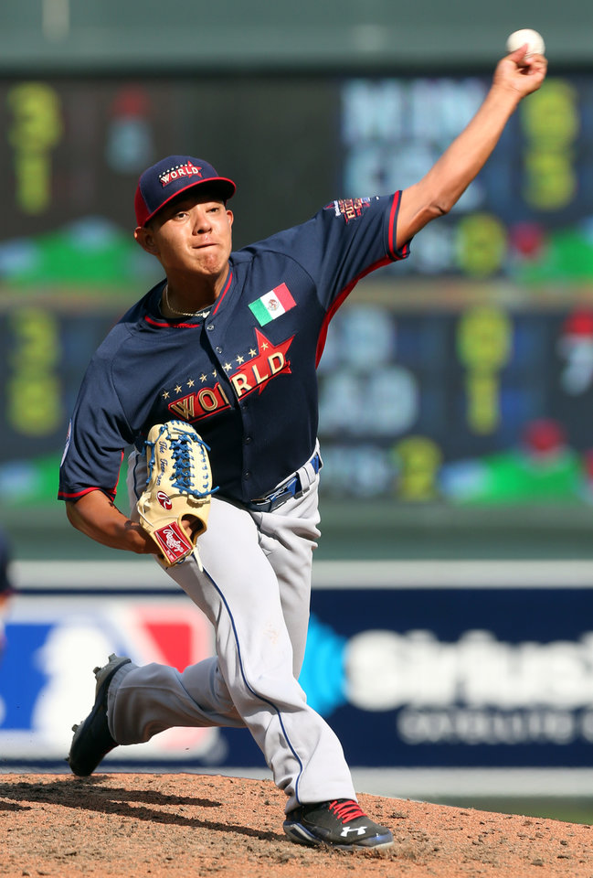 Photo - World's Julio Urias throws a pitch during the fifth inning of the All-Star Futures baseball game against the United States, Sunday, July 13, 2014, in Minneapolis. (AP Photo/Jim Mone)