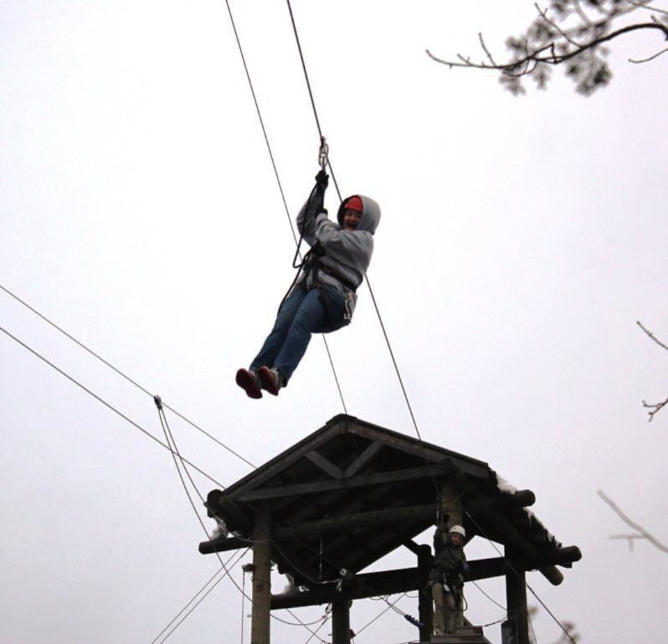 Photo - The Oklahoman Entertainment Writer Brandy McDonnell tries out the Branson Zipline Canopy Tours at Wolfe Creek Preserve. Photo provided.