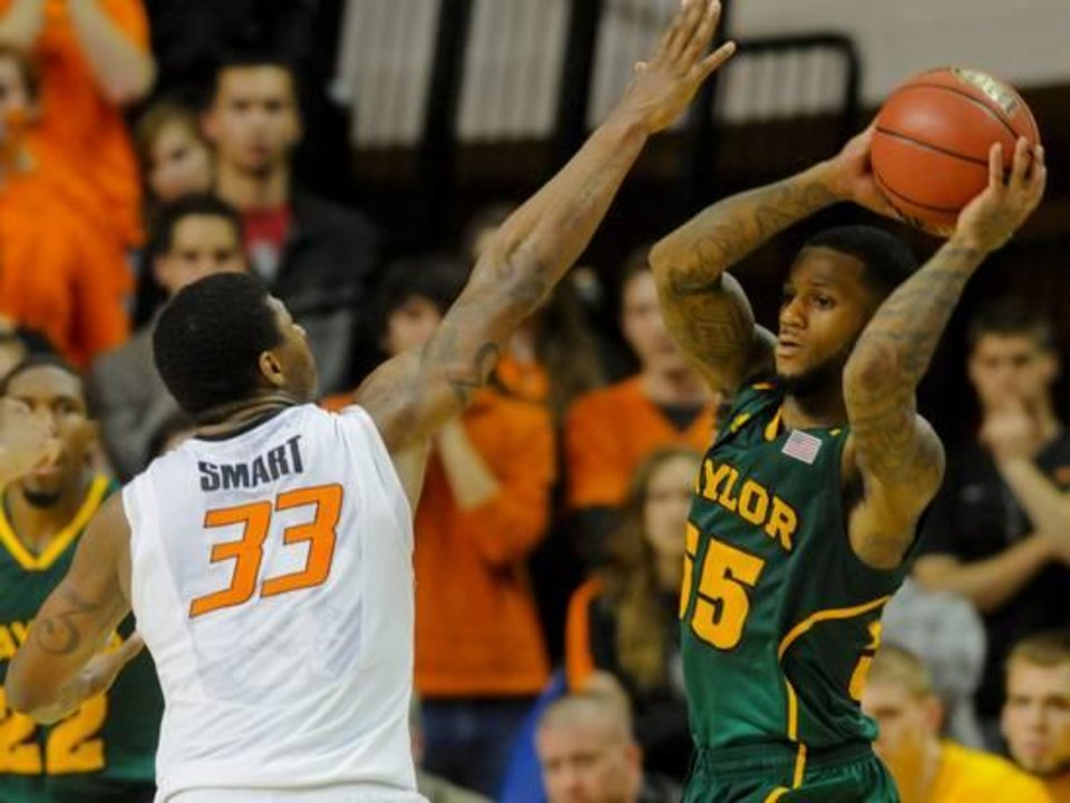 The Pierre Jackson-Marcus Smart showdown will be an intriguing one. / AP photo by Brody Schmidt
