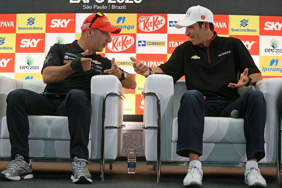 Photo - Brazilian IndyCar drivers Tony Kanaan, left, and Helio Castroneves talk during a news conference in Sao Paulo, Brazil, Thursday, May 2, 2013.  Brazil will host the 4th race of the Indy Car season on May 5. (AP Photo/Andre Penner)