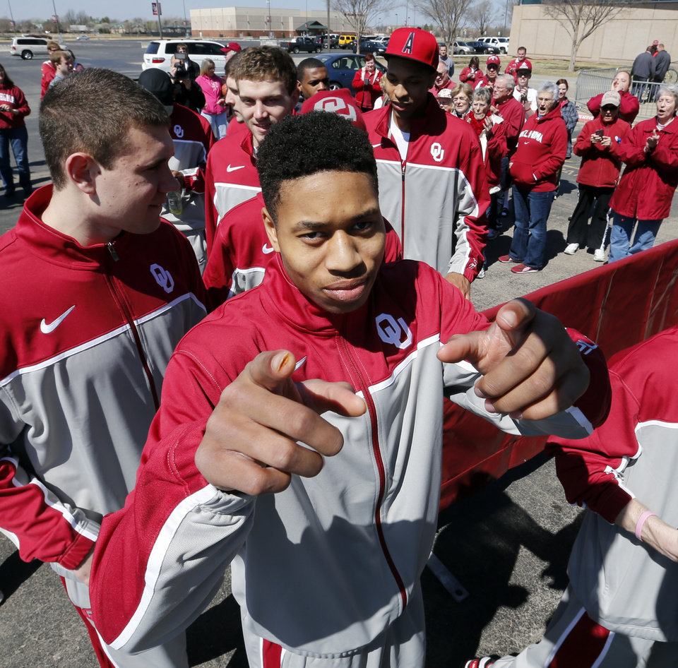 Isiah Cousins gestures to the camera as The University of Oklahoma Sooners (OU) men's basketball team leaves from The Lloyd Noble Center on Wednesday, March 20, 2013  in Norman, Okla. for their first round game in the NCAA Basketball Tournament.  Photo by Steve Sisney, The Oklahoman
