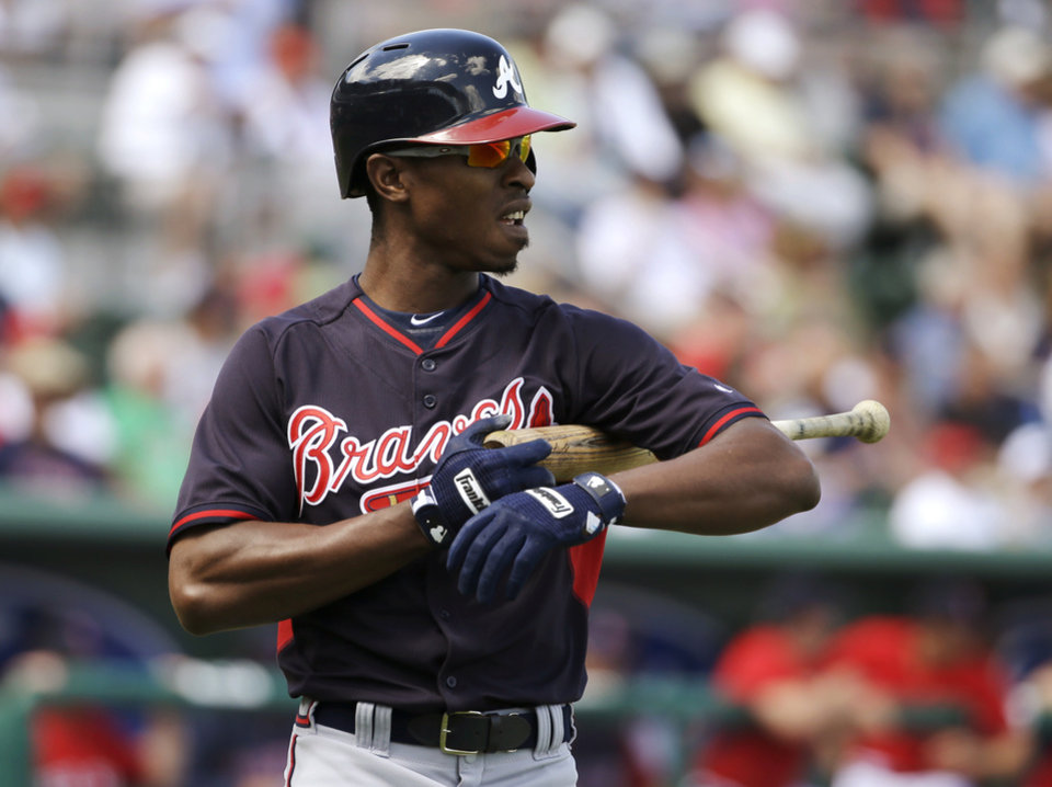 Photo - Atlanta Braves' B.J. Upton walks back to the dugout after he struck out looking on a pitch from Boston Red Sox's Felix Doubront in the first inning of an exhibition baseball game Friday, March 7, 2014, in Fort, Myers, Fla. The Red Sox won 4-1. (AP Photo/Steven Senne)