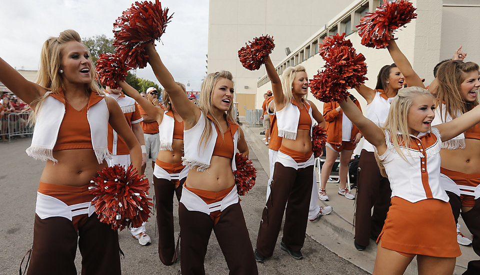 Photo - Members of the Texas cheer team bring in the Longhorn team busses during the Red River Rivalry college football game between the University of Oklahoma (OU) and the University of Texas (UT) at the Cotton Bowl in Dallas, Saturday, Oct. 13, 2012. Photo by Chris Landsberger, The Oklahoman