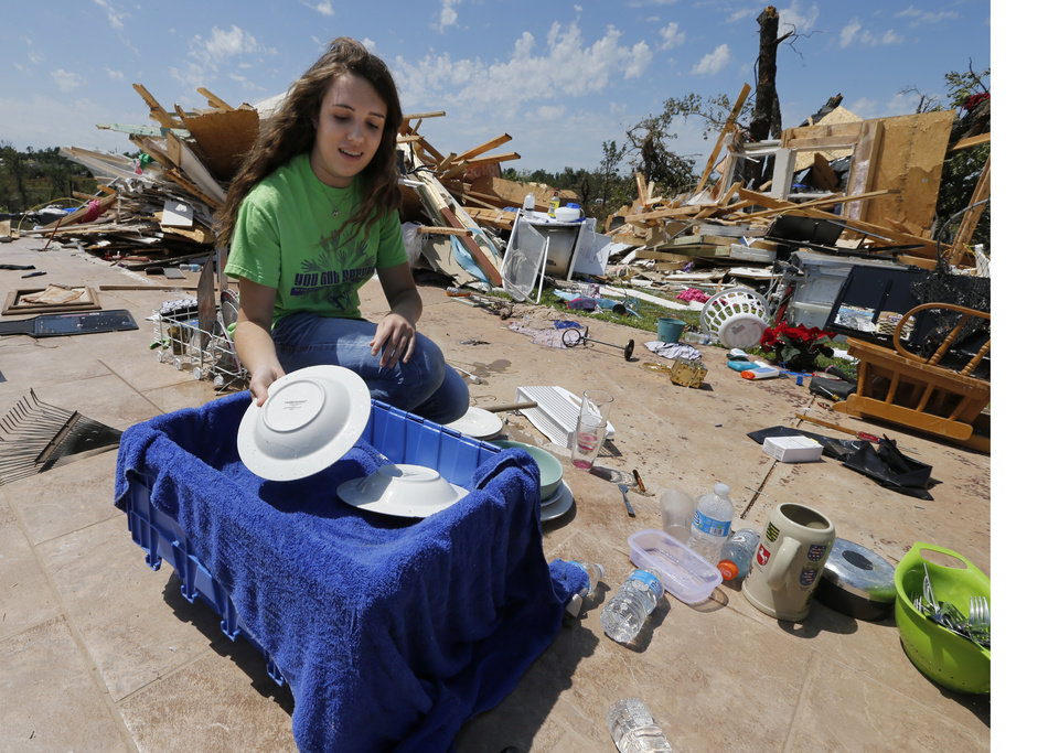 Photo - Taylor Church, Newalla, helps recover items from the home of her aunt and uncle Danny and Brenda Church on Thursday, May 23, 2013 in Little Axe, Okla.  The house was destroyed in Sunday's tornado in the Woodlands and Pecan Valley area.  Photo by Steve Sisney, The Oklahoman