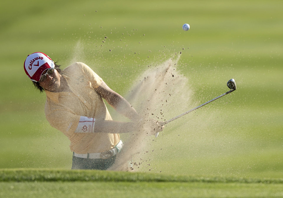Photo - Ryo Ishikawa, of Japan, blast the ball out of a bunker and into the cup for a birdie on the 15th hole during the second round of the Arnold Palmer Invitational golf tournament at Bay Hill Friday March 21, 2014, in Orlando, Fla. (AP Photo/Willie J. Allen Jr.)