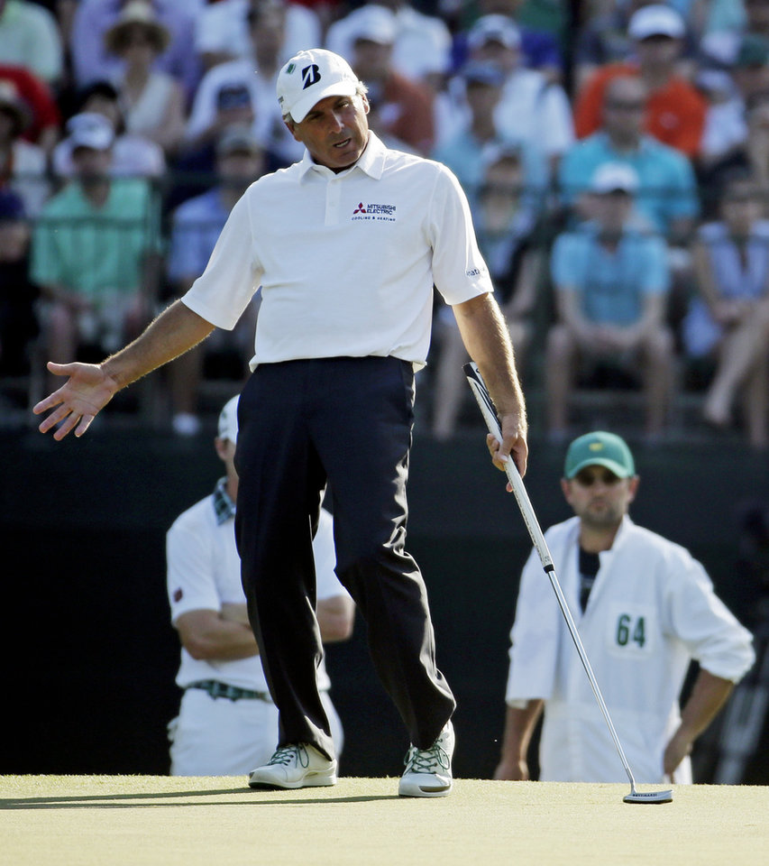 Photo - Fred Couples reacts after missing a putt on the 15th hole during the third round of the Masters golf tournament Saturday, April 12, 2014, in Augusta, Ga. (AP Photo/Chris Carlson)