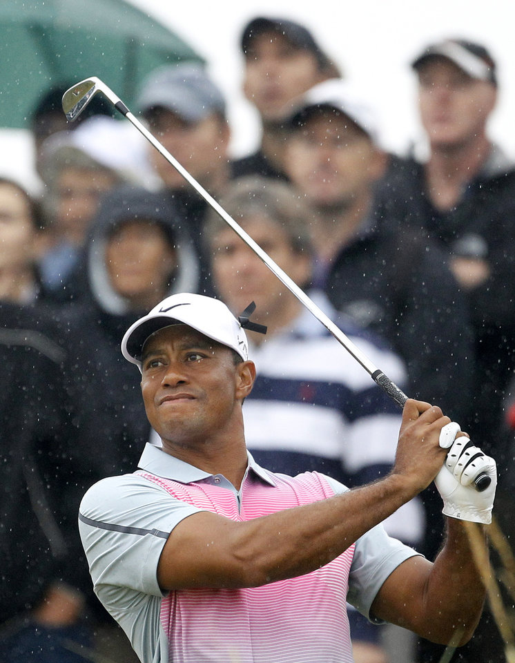 Photo - Tiger Woods of the US plays his tee shot from the 14th during the third day of the British Open Golf championship at the Royal Liverpool golf club, Hoylake, England, Saturday July 19, 2014. (AP Photo/Peter Morrison)