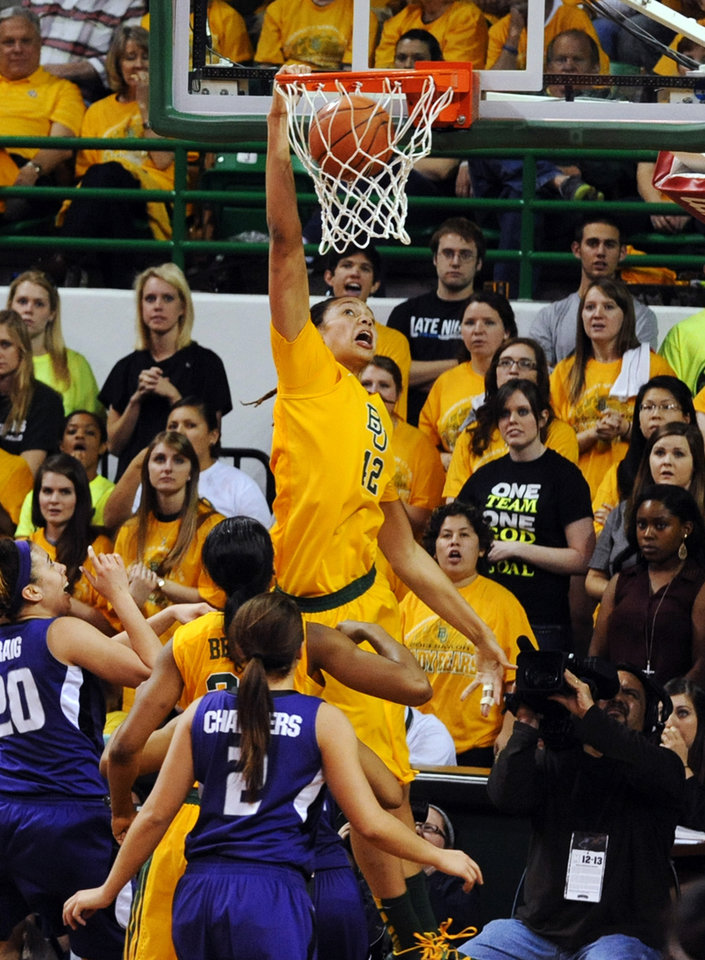 Photo - Baylor's Brittney Griner (42) dunks over Kansas State's Bri Craig (20) and Brittany Chambers (2) in the second half of their NCAA college basketball game, Monday, March, 4, 2013, in Waco, Texas. Baylor won 90-68. (AP Photo/The Waco Tribune-Herald, Rod Aydelotte)
