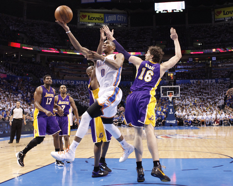 Photo - Oklahoma City's Russell Westbrook puts up a shot past Los Angeles' Pau Gasol during Game 2 in the second round of the NBA playoffs between the Oklahoma City Thunder and the L.A. Lakers at Chesapeake Energy Arena on Wednesday,  May 16, 2012, in Oklahoma City, Oklahoma. Photo by Chris Landsberger, The Oklahoman