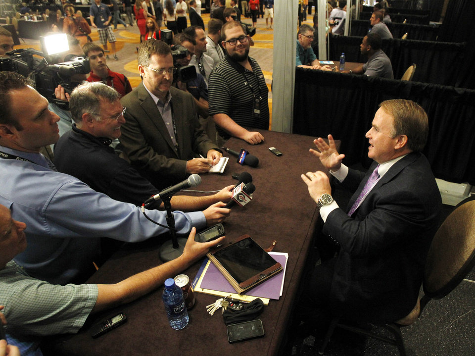 TCU football coach Gary Patterson conducts interviews during a breakout session at the Big 12 Conference Football Media Days Monday, July 22, 2013 in Dallas.  (AP Photo/Tim Sharp)