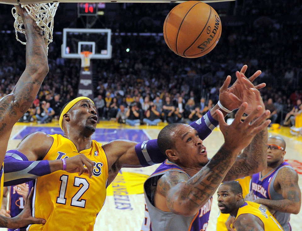 Phoenix Suns guard Shannon Brown, right, puts up a shot as Los Angeles Lakers center Dwight Howard defends during the first half of their NBA basketball game, Friday, Nov. 16, 2012, in Los Angeles. (AP Photo/Mark J. Terrill)