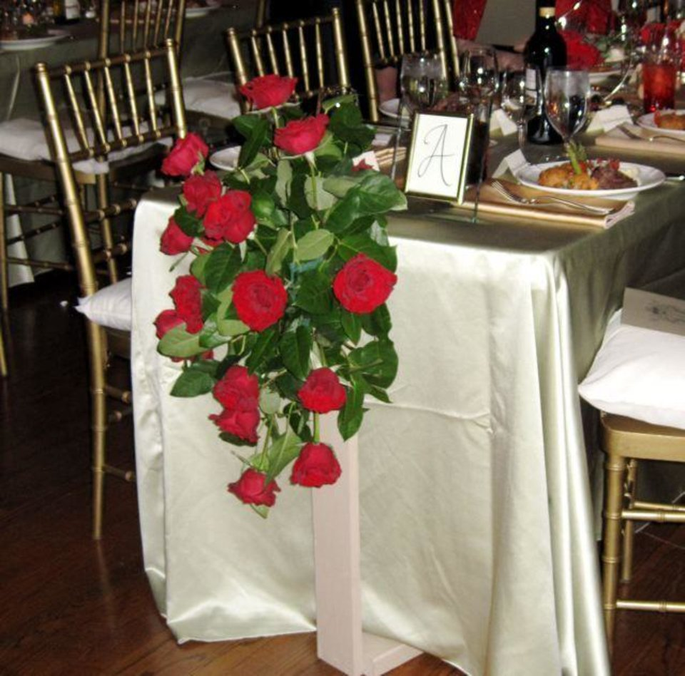BEAUX ARTS BALL....Red rose sprays decorated the aisle. (Photo by  Helen Ford Wallace).