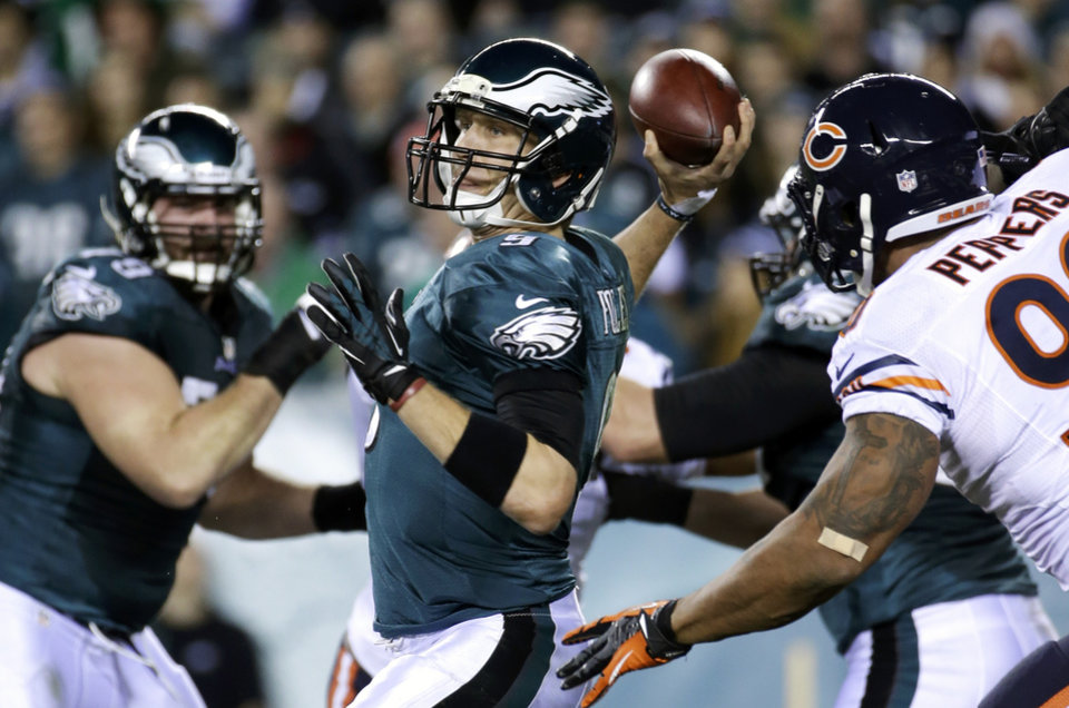 Photo - Philadelphia Eagles' Nick Foles passes during the first half of an NFL football game against the Chicago Bears, Sunday, Dec. 22, 2013, in Philadelphia. (AP Photo/Matt Rourke)