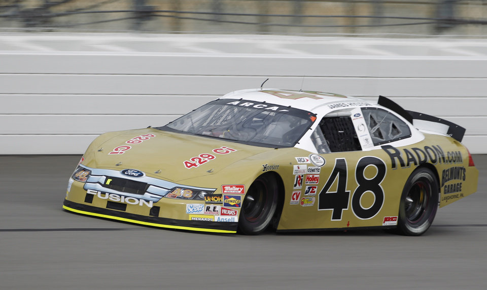 Photo - ARCA driver James Hylton takes a lap during practice at Kansas Speedway in Kansas City, Kan., Friday, Oct. 4, 2013. The 79-year-old will retire following Friday night's ARCA Kansas Lottery 98.9 race. (AP Photo/Colin E. Braley)
