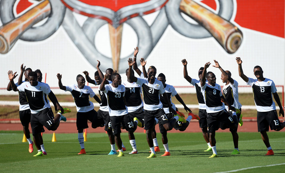 Photo - Ghana players exercise on the pitch during a training session in Brasilia, Brazil, Wednesday, June 25, 2014. Ghana will play Portugal in group G of the 2014 soccer World Cup on June 26. (AP Photo/Paulo Duarte)