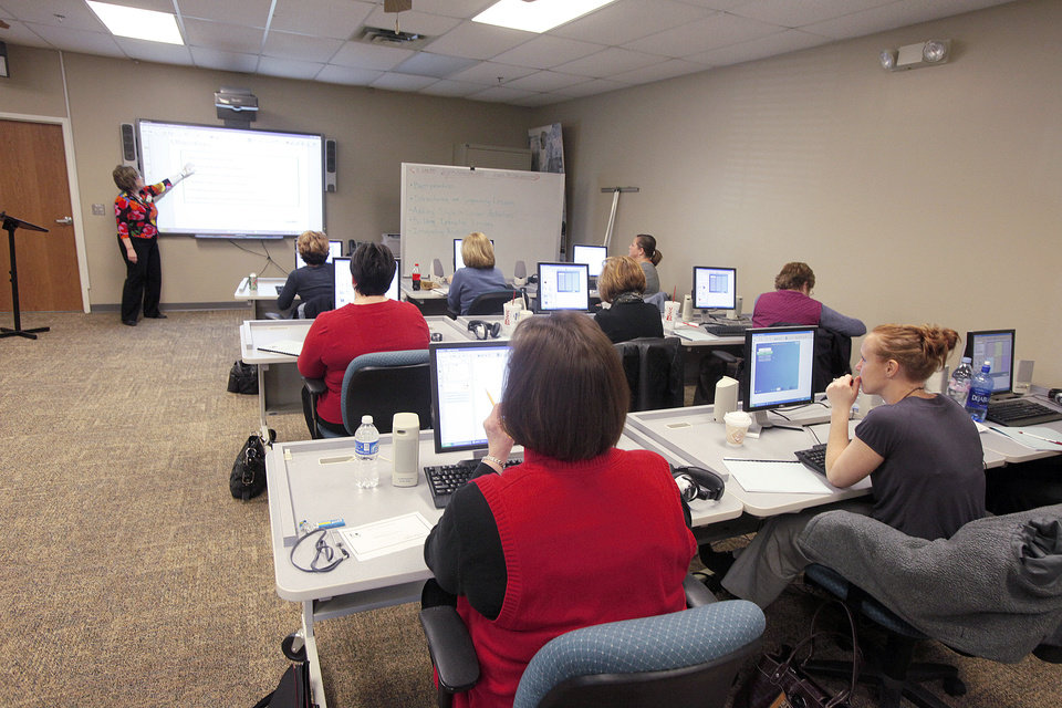 Photo - Edmond teachers learn to use the SMARTboard.