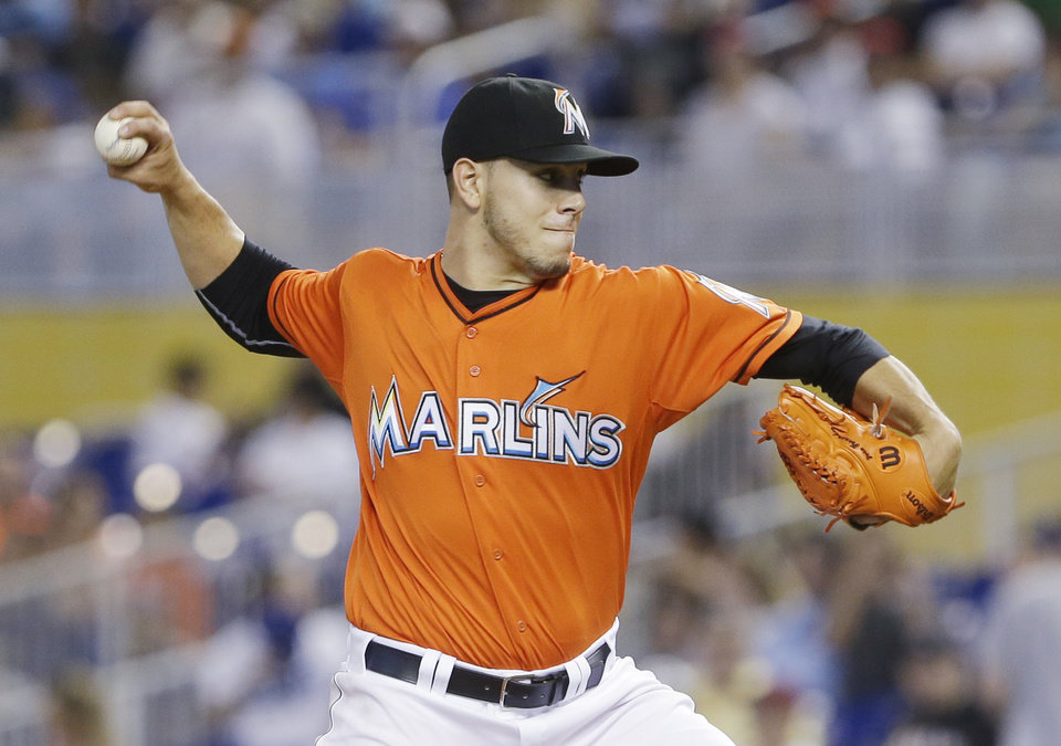 Photo - Miami Marlins' Jose Fernandez delivers a pitch during the first inning of a baseball game against the Los Angeles Dodgers, Sunday, May 4, 2014, in Miami. (AP Photo/Wilfredo Lee)
