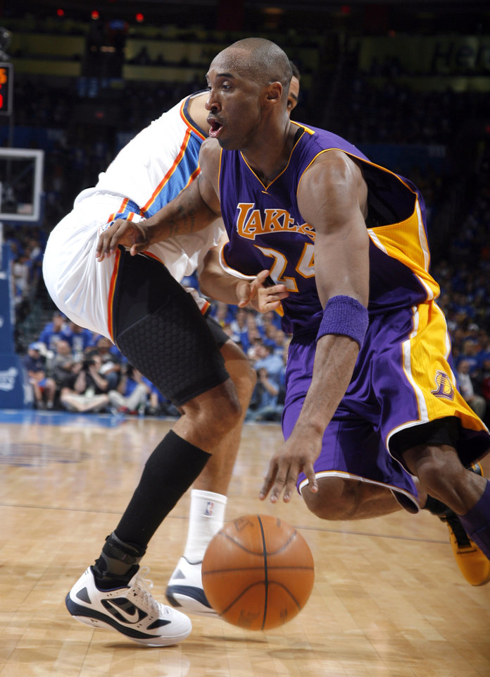 Los Angeles' Kobe Bryant (24) drives to the basket past Oklahoma City's Thabo Sefolosha (2) during Game 1 in the second round of the NBA playoffs between the Oklahoma City Thunder and the L.A. Lakers at Chesapeake Energy Arena in Oklahoma City, Monday, May 14, 2012. Photo by Sarah Phipps, The Oklahoman