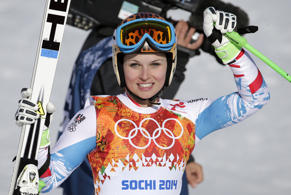 Photo - Austria's Anna Fenninger pauses in the finish area after competing in the women's super-G at the Sochi 2014 Winter Olympics, Saturday, Feb. 15, 2014, in Krasnaya Polyana, Russia.(AP Photo/Gero Breloer)