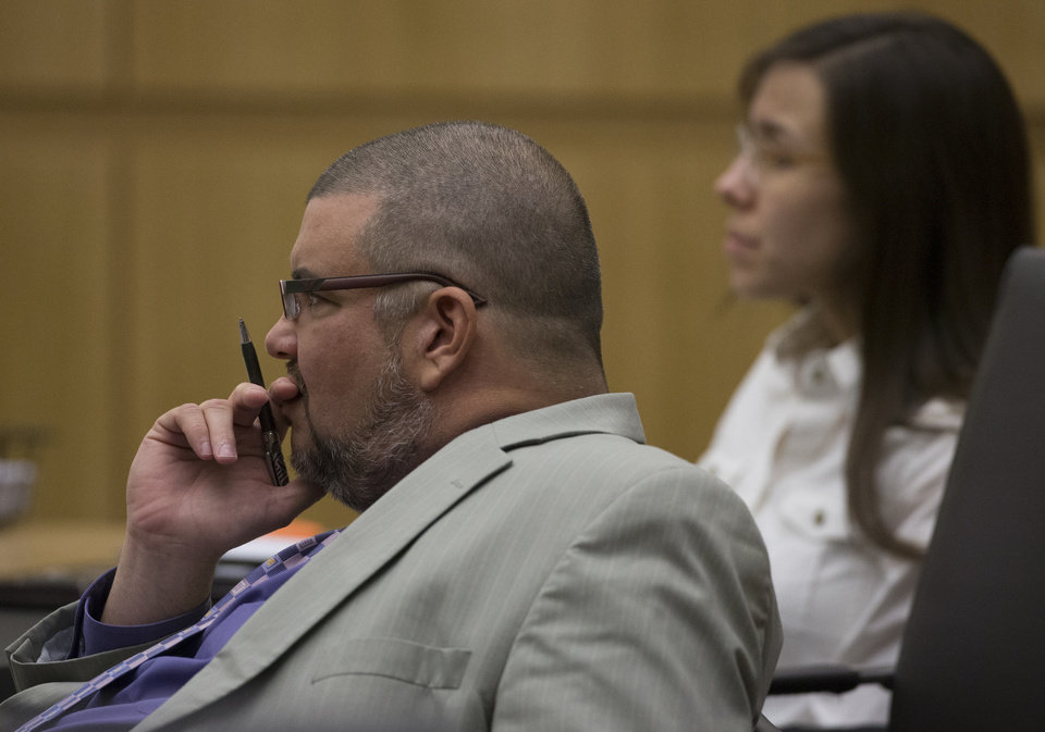 Photo - Defense attorney Kirk Nurmi, left, listens during the Jodi Arias trial at Maricopa County Superior Court in Phoenix on Thursday, April 18, 2013. Arias faces a potential death sentence if convicted of first-degree murder in Travis Alexander's June 2008 killing at his suburban Phoenix home. (AP Photo/The Arizona Republic, Mark Henle, Pool)