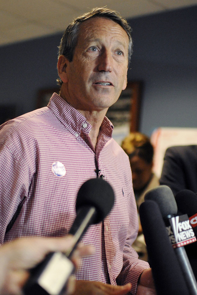 Photo - Former South Carolina Gov. Mark Sanford speaks to the media after voting at a polling place in Charleston, S.C., Tuesday, May 7, 2013.   Sanford, a Republican, and Colbert Busch, a Democrat and sister of political satirist Stephen Colbert, are to face off for the 1st Congressional District seat, that was vacated when Tim Scott was appointed to the U.S. Senate. Green Party candidate Eugene Platt also is on the ballot. (AP Photo/Rainier Ehrhardt)