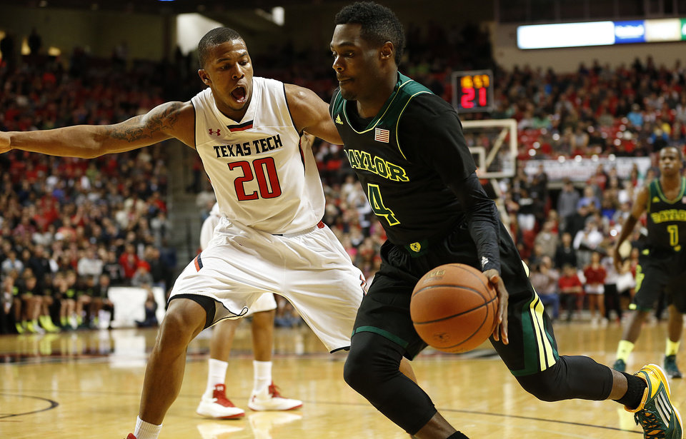 Photo - Baylor's Gary Franklin (4) drives against Texas Tech's Toddrick Gotcher during an NCAA college basketball game in Lubbock, Texas, Wednesday, Jan, 15, 2014. (AP Photo/Lubbock Avalanche-Journal, Tori Eichberger) ALL LOCAL TV OUT