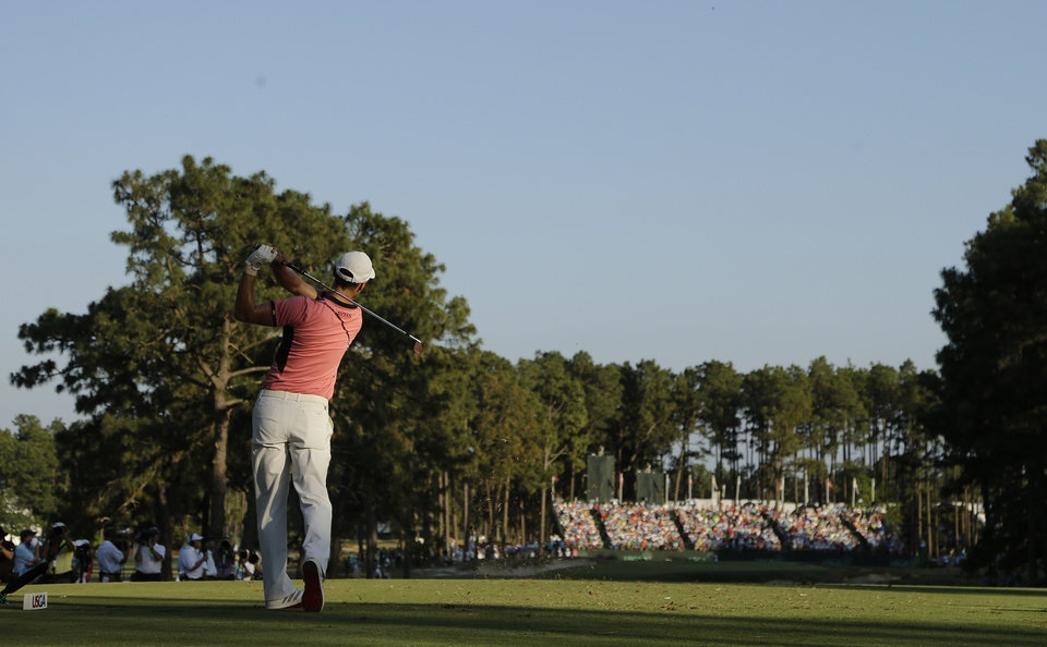 Photo - Martin Kaymer, of Germany, watches his tee shot on the 17th hole during the third round of the U.S. Open golf tournament in Pinehurst, N.C., Saturday, June 14, 2014. (AP Photo/Chuck Burton)