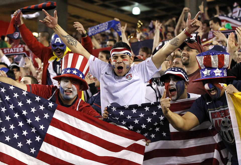 Photo - FILE -  In a Jan. 21, 2012, file photo United States soccer fans celebrate a game-winning goal against Venezuela in the second half of a friendly soccer match in Glendale, Ariz.  ESPN and Fox executives see devoted fans at Major League Soccer matches and figure burgeoning national television viewership is soon to follow.    (AP Photo/Ross D. Franklin)