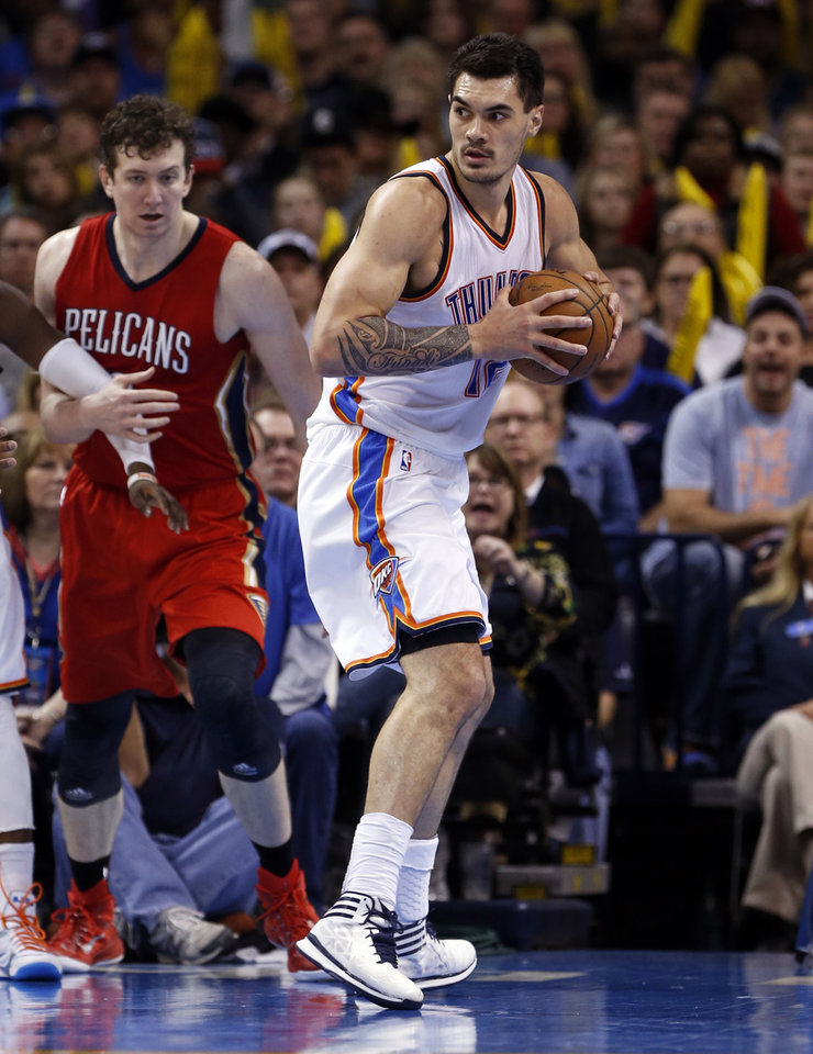 Photo - Thunder's Steven Adams (12) gets a rebound during the second half of an NBA basketball game between the Oklahoma City Thunder and the New Orleans Pelicans at Chesapeake Energy Arena on Dec. 21, 2014 in Oklahoma City, Okla. Photo by Steve Sisney, The Oklahoman